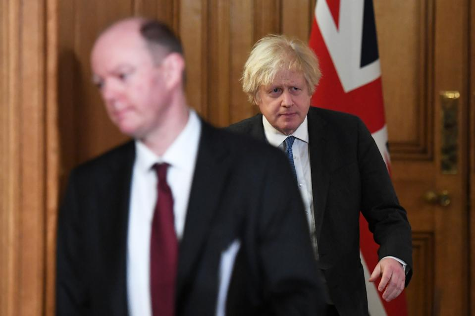 LONDON, ENGLAND - FEBRUARY 15: UK Prime Minister Boris Johnson (right) and UK Chief Medical Officer Chris Whitty arrive for a Covid-19 media briefing at Downing Street on February 15, 2021 in London, England. (Photo by Stefan Rousseau - WPA Pool/Getty Images)