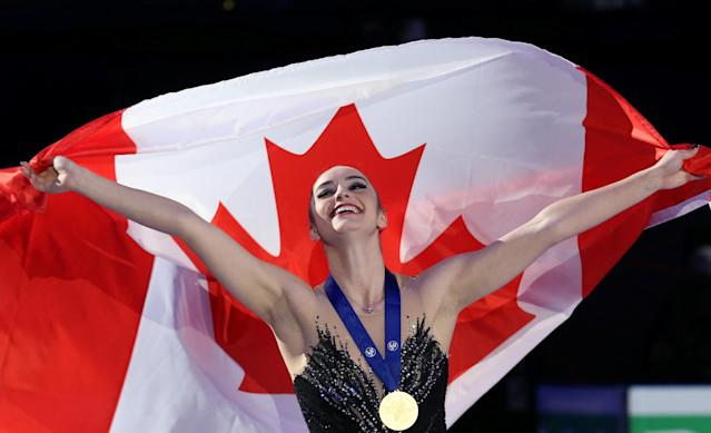 Figure Skating - World Figure Skating Championships - The Mediolanum Forum, Milan, Italy - March 23, 2018 Canada's Kaetlyn Osmond celebrates with her medal after winning gold in the Ladies Free Skating REUTERS/Alessandro Bianchi