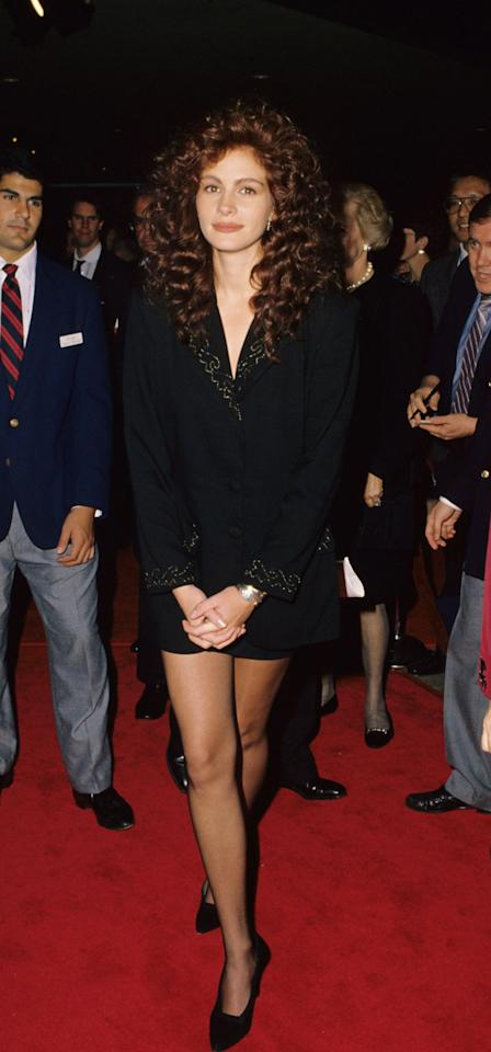 <p>Julia began her red carpet reign at the NYC premiere of <strong>Steel Magnolias</strong> in the type of look she still reaches for today: oversize suiting and a miniskirt to show off her toned legs.</p>
