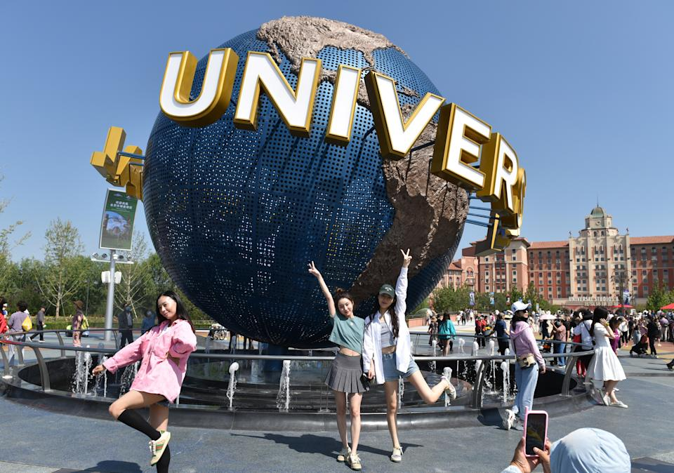 BEIJING                         , CHINA - SEPTEMBER 07 2021: Tourists stop by the iconic sculpture of the Universal Studios theme park in Beijing, China Tuesday, Sept. 07, 2021. (Photo credit should read Feature China/Barcroft Media via Getty Images)