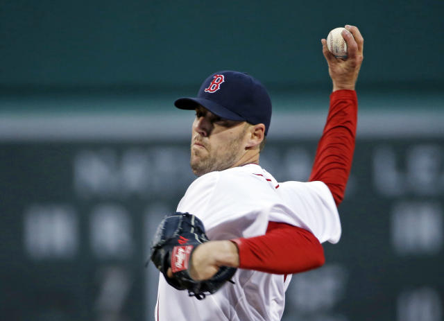 Boston Red Sox starting pitcher John Lackey delivers to the New York Yankees during the first inning of a baseball game at Fenway Park in Boston, Wednesday, April 23, 2014. (AP Photo/Elise Amendola)