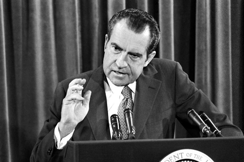 """In this June 29, 1972, file photo, President Richard Nixon gestures during his news conference in Washington. As Barack Obama arrives in Israel for his first trip there as president, a 1972 recording shows that Nixon complained of the Democrats' """"dishonest"""" platform language _ declaring Jerusalem the capital of Israel. On the previously unreported taped conversation, Nixon suggested that Democratic military cuts would leave Israel vulnerable to military aggression. Israel had fought a war against its Arab neighbors five years earlier.  (AP Photo/File)"""