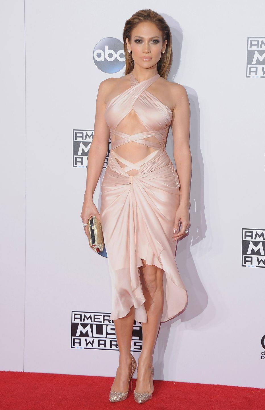 <p>Another red carpet, another ab-baring dress. Jennifer stuns in a slicked-back 'do, sparkly silver heels, and neutral halter number at the American Music Awards.</p>