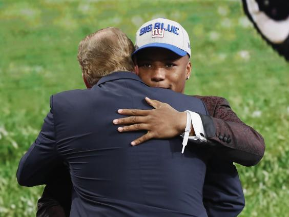 Saquon Barkley of Penn State University hugs Goodell after being picked number two overall by the New York Giants during the first round of the 2018 NFL Draft (Getty)