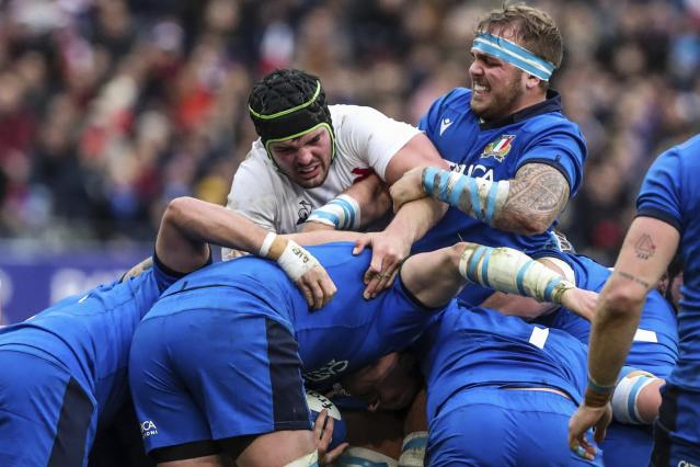 France rugby player Gregory Alldritt, center and left, Italy's Niccolo Cannone, center and right, during a scrum during the Six Nations international rugby union match at the Stade de France stadium, in Saint Denis, north of Paris, Sunday, Feb. 9, 2020. (AP Photo/Thibault Camus)