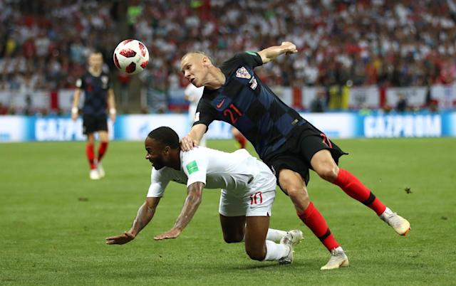 Croatia's Domagoj Vida beats Raheem Sterling to the ball, but can't escape from the unforgiving Russian fans