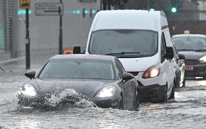 Thunder storms and heavy rain caused flash flooding around the British capital - AFP