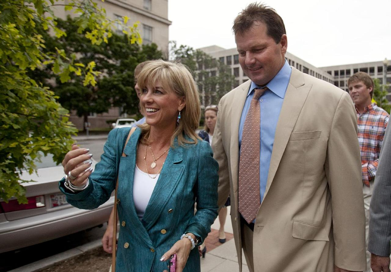Debbie Clemens, left, smiles while leaving federal court with her husband, former Major League Baseball pitcher Roger Clemens, in Washington, Monday, June 18, 2012, after he was acquitted on all charges by a jury that decided that he didn't lie to Congress when he denied using performance-enhancing drugs. At back right is their son Kacy. (AP Photo/Jacquelyn Martin)