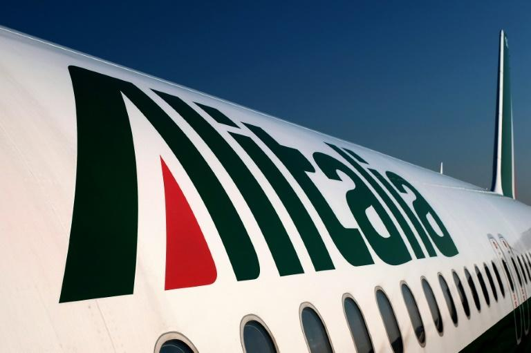 Troubled airline Alitalia is planning to make 2,400 staff redundant and cut some salaries by almost a third, trade union sources said
