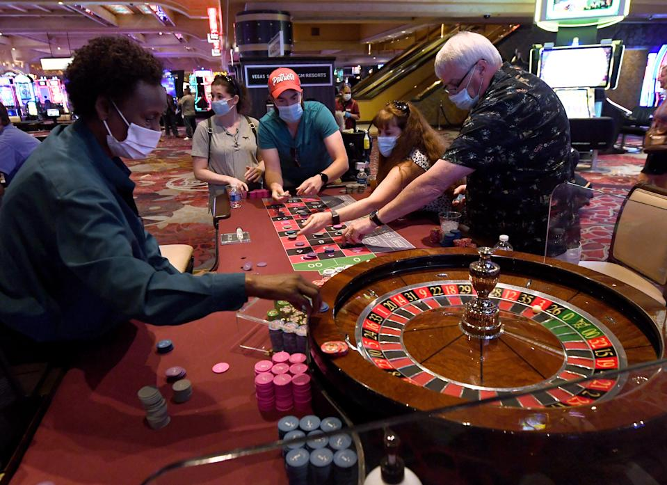 LAS VEGAS, NEVADA - JUNE 11:  Guests play roulette at Excalibur Hotel & Casino after the Las Vegas Strip property opened for the first time since being closed in mid-March because of the coronavirus (COVID-19) pandemic on June 11, 2020 in Las Vegas, Nevada. Hotel-casinos throughout the state were allowed to open on June 4 as part of a phased reopening of the economy with social distancing guidelines and other restrictions in place. Excalibur is MGM Resorts International's fourth Las Vegas location to reopen for business following its Bellagio Resort & Casino, New York-New York Hotel & Casino, MGM Grand Hotel & Casino and The Signature properties on June 4.  (Photo by Ethan Miller/Getty Images)