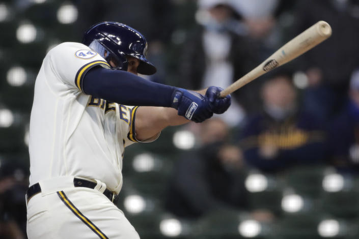 Milwaukee Brewers' Travis Shaw hits a two-RB double during the ninth inning of an opening day baseball game against the Minnesota Twins, Thursday, April 1, 2021, in Milwaukee. (AP Photo/Aaron Gash)