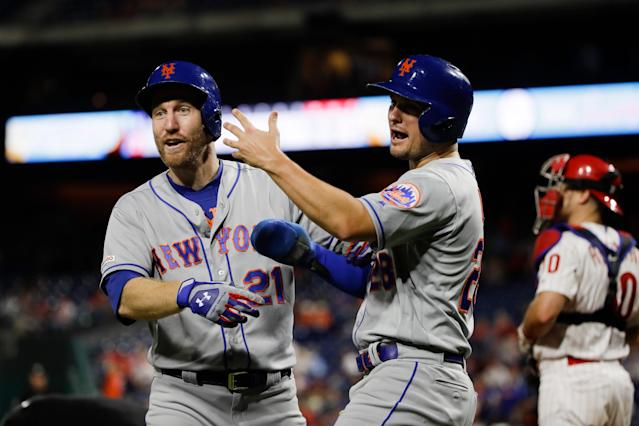 New York Mets' Todd Frazier, left, celebrates with J.D. Davis after hitting a three-run home run off Philadelphia Phillies relief pitcher Edgar Garcia during the ninth inning of a baseball game, Friday, Aug. 30, 2019, in Philadelphia. (AP Photo/Matt Rourke)