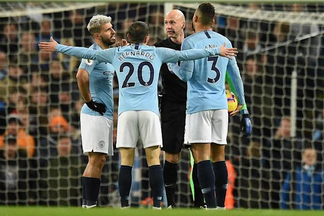 Manchester City are four points behind leaders Liverpool in the Premier League after beating their title rivals 2-1 (AFP Photo/Oli SCARFF )