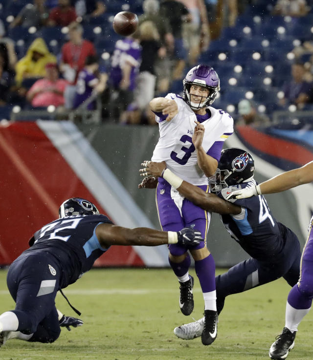 Minnesota Vikings quarterback Trevor Siemian (3) passes as he is pressured by Tennessee Titans defenders Julius Warmsley (72) and Josh Carraway (44) in the first half of a preseason NFL football game Thursday, Aug. 30, 2018, in Nashville, Tenn. (AP Photo/James Kenney)
