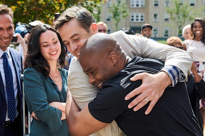 CELEBRATING FREEDOM: Valentino Dixon (right) and Max Adler embrace.
