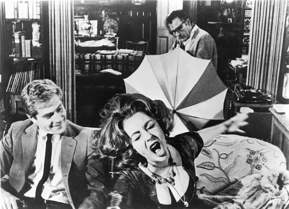 "George Segal (from left), Elizabeth Taylor and Richard Burton (back) star in the marital black comedy ""Who's Afraid of Virginia Woolf?"""