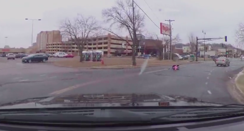 The child was lying in her car seat in the middle of a busy road. Source: Storyful/ Chad Mock
