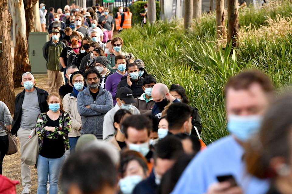People queuing up with face masks on during the Covid pandemic.