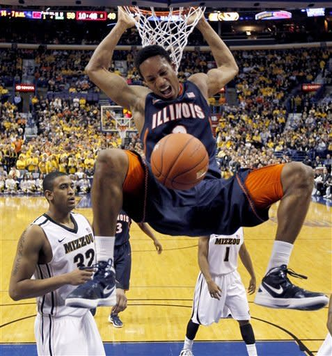 Illinois' Joseph Bertrand dunks as Missouri's Steve Moore, left, looks on during the second half of an NCAA college basketball game Thursday, Dec. 22, 2011, in St. Louis. Missouri won 78-74. (AP Photo/Jeff Roberson)