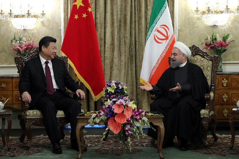 Iranian President Hassan Rouhani (R) meets Chinese President Xi Jinping in Tehran (AFP Photo/)