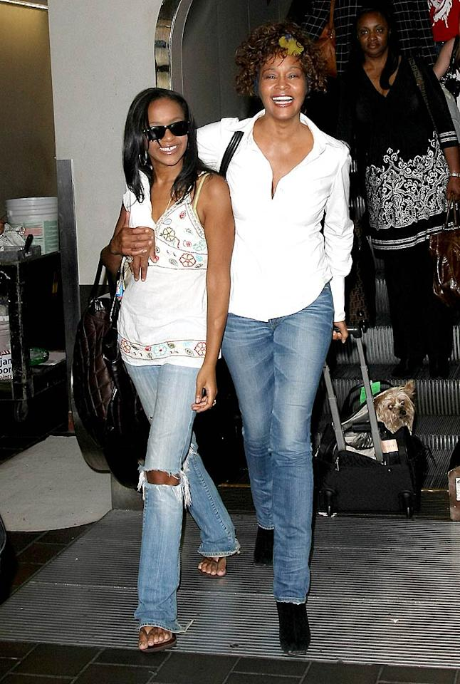 """Whitney Houston and her 16-year-old daughter with Bobby Brown are all smiles at Newark Airport. We haven't seen Bobbi Kristina since """"Being Bobby Brown"""" was on the air, but it looks like she's grown into a beautiful young lady. <a href=""""http://www.infdaily.com"""" target=""""new"""">INFDaily.com</a> - August 20, 2009"""