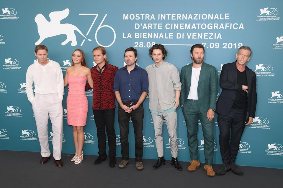 """VENICE, ITALY - SEPTEMBER 02:   (L-R) Sean Harris, Lily-Rose Depp, Tom Glynn-Carney, Director David Michod, Timothee Chalamet, Joel Edgerton and Ben Mendelsohn attend """"The King"""" photocall during the 76th Venice Film Festival at Sala Grande on September 02, 2019 in Venice, Italy. (Photo by Stephane Cardinale - Corbis/Corbis via Getty Images)"""