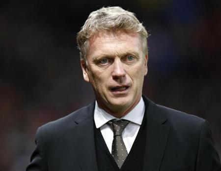Manchester United manager David Moyes attends their English FA Cup soccer match against Swansea City at Old Trafford in Manchester