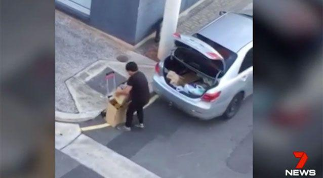 A man seen unloading boxes of formula from his car. Photo: 7 News