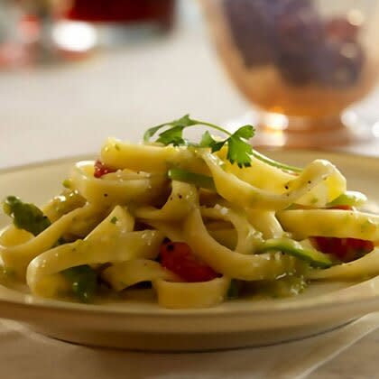 """<p>""""Asparagus is a great option because it contains vitamins A for healthy cells and vitamin K for blood clotting, and studies show it has anti-inflammatory properties,"""" says <a href=""""http://www.barilla.com"""" target=""""_blank"""">Barilla</a> registered dietitian Anna Rosales."""" If you don't have or like the taste of asparagus, Barilla executive chef Lorenzo Boni, who developed the recipe, recommends using trimmed and quartered artichokes or sliced zucchini. (If you love it? Here are some <a href=""""https://www.shape.com/healthy-eating/healthy-recipes/springtime-asparagus-recipes-breakfast-lunch-and-dinner"""" target=""""_blank"""">asparagus recipes for breakfast, lunch, and dinner</a>.)</p> <p><strong>Serves:</strong> 8</p> <p><strong>Ingredients:</strong><br /> 1 box (16 ounces) fettuccine<br /> 2 tablespoons minced shallots<br /> 2 tablespoons extra-virgin olive oil <br /> 2 bunches asparagus, thinly sliced<br /> Salt<br /> Pepper <br /> 1 cup chicken broth <br /> 1 cup cherry tomatoes, quartered<br /> 1 tablespoon chopped fresh Italian parsley<br /> 1/2 cup grated Parmesan cheese</p> <p><strong>Directions:</strong><br /> Cook pasta according to package directions. Meanwhile, sauté shallots in olive oil in a medium-sized skillet over medium heat for 3 minutes. Add asparagus and season with salt and pepper. Add broth and simmer for 2 minutes. Blend approximately 1/3 mixture in a covered blender until well combined, then return mixture to the skillet. Add fettuccine and tomatoes and toss for 2 minutes. Stir in parsley and cheese before serving.</p> <p><strong>Nutrition score per serving:</strong> 280 calories, 7g fat (2g saturated), 46g carbs, 11g protein, 2g fiber</p>"""