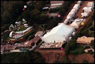 """<p>Pitt and Aniston tie the knot in a <em>lavish </em>Malibu wedding, which is naturally hounded by paparazzi—thus the aerial shots. Look at all those tents! The phrase """"media circus"""" couldn't be more apt. </p>"""