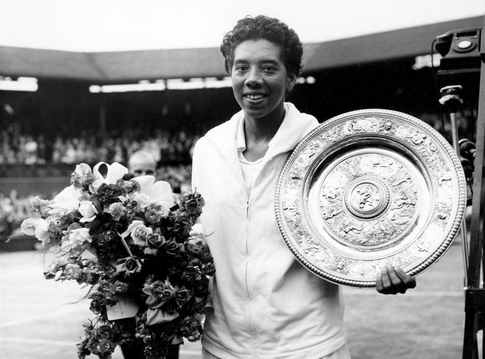 Picture taken on July 5, 1958 at Wimbledon showing American tennis player Althea Gibson after winning the Wimbledon lawn tennis championships. (Photo by - / INTERNATIONAL NEWS PHOTOS / AFP) / France ONLY        (Photo credit should read -/AFP via Getty Images)