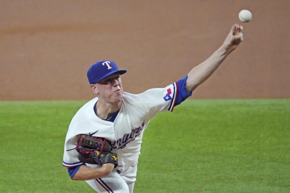 Texas Rangers starting pitcher Kolby Allard throws a pitch in the first inning against the Oakland Athletics in a baseball game Thursday, June 24, 2021, in Arlington, Texas. (AP Photo/Louis DeLuca)