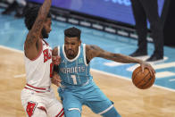 Charlotte Hornets guard Malik Monk, right, is defended by Chicago Bulls guard Coby White during the first quarter of an NBA basketball game in Charlotte, N.C., Thursday, May 6, 2021. (AP Photo/Nell Redmond)