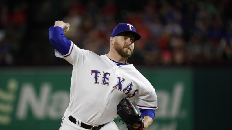 Texas Rangers' pitcher Shawn Kelley tossed one halfway to the moon. (AP Photo/Tony Gutierrez)