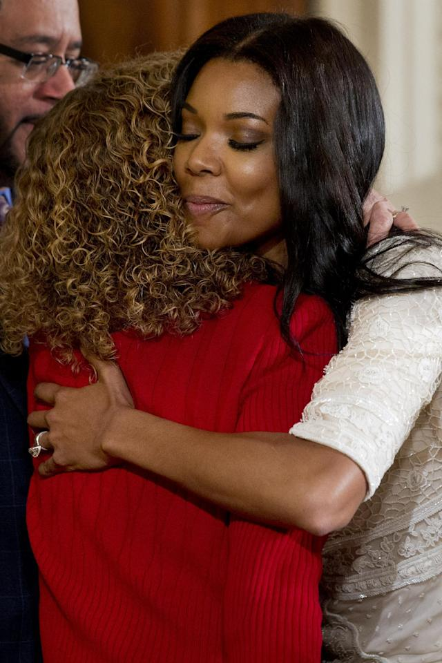 Rep. Debbie Wasserman Schultz, D-Fla., hugs actress Gabrielle Union, fiance of Miami Heat basketball player Dwyane Wade, in the East Room of the White House in Washington, Tuesday, Jan. 14, 2014, prior to the start of a ceremony where President Barack honored the Miami Heat 2013 NBA Champion basketball team. (AP Photo/Jacquelyn Martin)