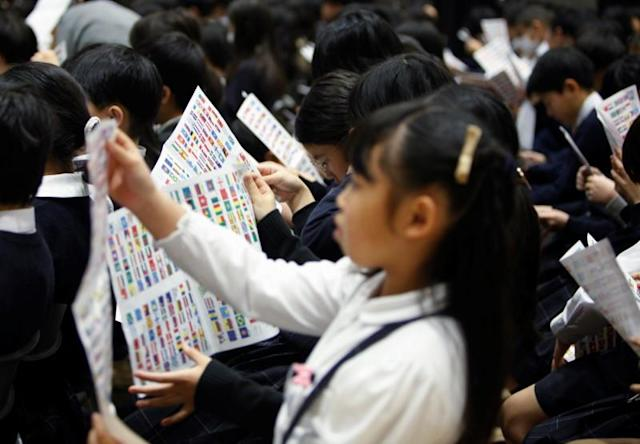 School students participate in a special lecture about national flags by Tokyo 2020 Olympic and Paralympic Games flag organiser Tadamasa Fukiura in Tokyo