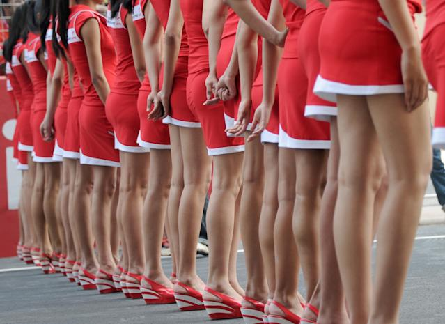 Grand Prix grid girls stand on the track during the drivers' parade in Formula One's Indian Grand Prix at the Buddh International circuit in Greater Noida, southeastern outskirts of New Delhi on October 30, 2011. AFP PHOTO / TOSHIFUMI KITAMURA (Photo credit should read TOSHIFUMI KITAMURA/AFP/Getty Images)