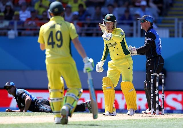 """Australia's captain Michael Clarke (C) labelled his side's batting in their World Cup match against New Zealand as """"horrendous"""" (AFP Photo/Michael Bradley)"""