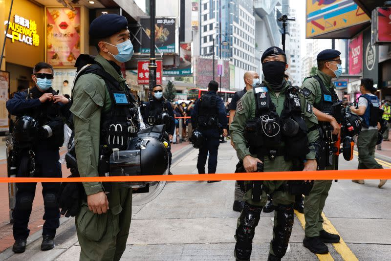 Police stand guard to avoid mass gathering during protest in Hong Kong