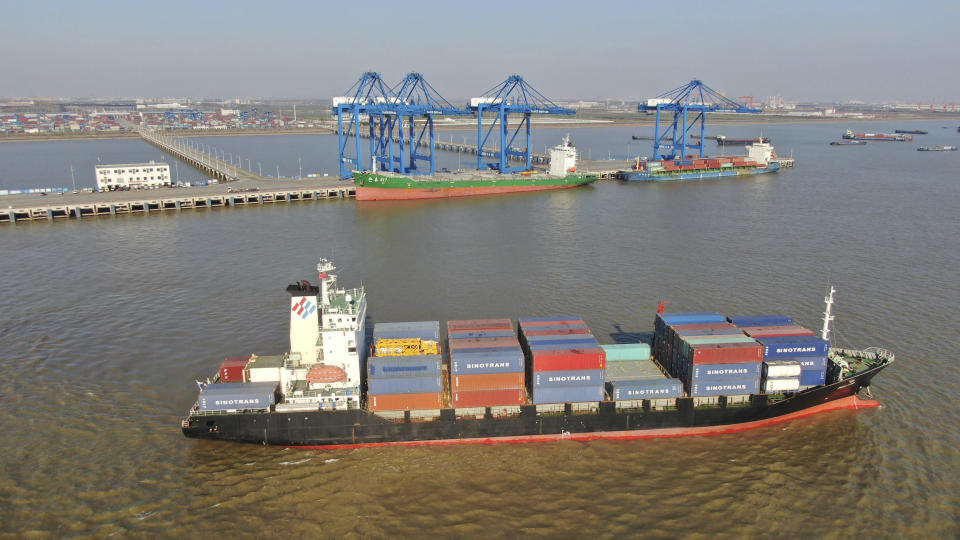 A container ship leaves a port in Nantong in eastern China's Jiangsu Province, Dec. 20, 2020. China's exports rose in 2020 despite pressure from the coronavirus pandemic and a tariff war with Washington, boosting its politically volatile trade surplus to $535 billion, one of the highest ever reported. (Chinatopix via AP)