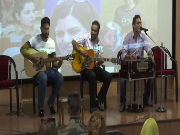 Artists performing during a program in Srinagar on Thursday. [Photo/ANI]