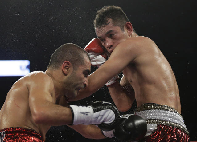 Nonito Donaire, right, lands a punch on Vic Darchinyan during round 6 of their featherweight rematch, Saturday, Nov. 9, 2013, in Corpus Christi, Texas. (AP Photo/Eric Gay)