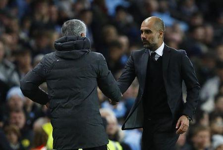 Britain Soccer Football - Manchester City v Manchester United - Premier League - Etihad Stadium - 27/4/17 Manchester City manager Pep Guardiola and Manchester United manager Jose Mourinho at the end of the match Action Images via Reuters / Jason Cairnduff Livepic