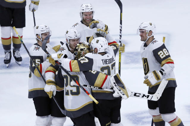The Vegas Golden Knights celebrate Shea Theodore's shootout goal against the Chicago Blackhawks in an NHL hockey game Tuesday, Oct. 22, 2019, in Chicago. The Golden Knights won 2-1. (AP Photo/Charles Rex Arbogast)