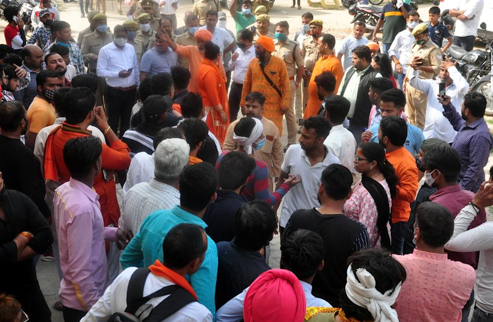 Supporters of a Hindu organization demonstrated at the Dasna Devi temple where a few days ago, a minor was thrashed for drinking water, at Dasna on March 19, 2021 in Ghaziabad, India. The Devi temple of Dasna, Ghaziabad had come under limelight after a teenage Muslim boy named Asif claimed that he was beaten for trying to drink some water inside the temple premises. The Head Priest (Mahant) Yati Narsinghanand claimed that the temple management was forced to bar Muslims entry into the temple premises after incidents of theft, assault and sexual harassment of female devotees. Dhaulana MLA Aslam Chaudhary has called for removal of board, this led Hindu organizations to come in support saying they will not let the board be removed. (Photo by Sakib Ali/Hindustan Times via Getty Images)