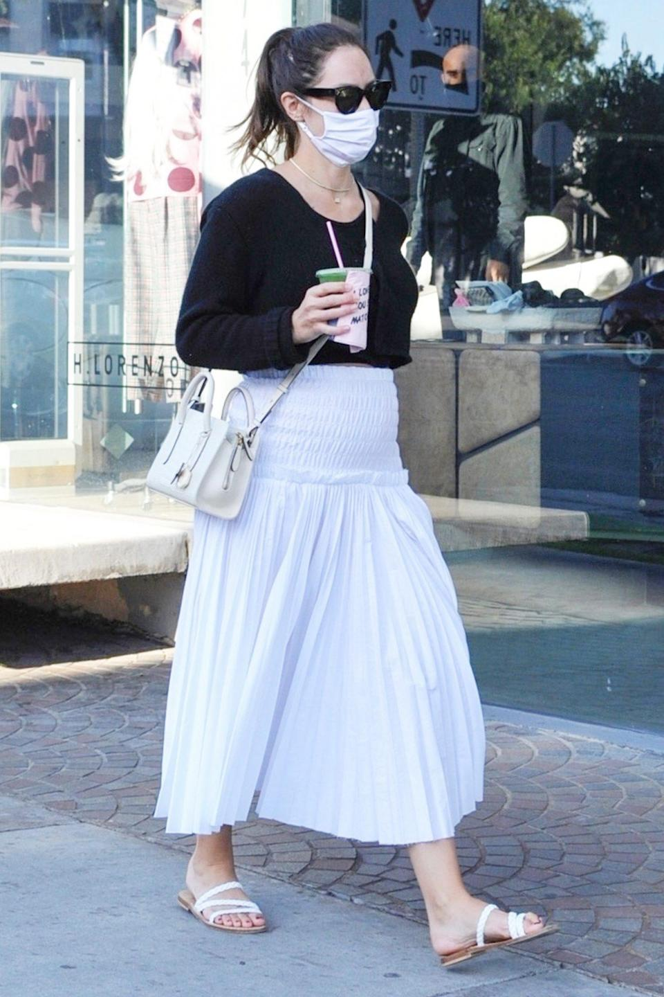 <p>Katharine McPhee grabs a drink from Cha Cha Matcha on her way to go shopping for baby clothes in West Hollywood on Monday.</p>