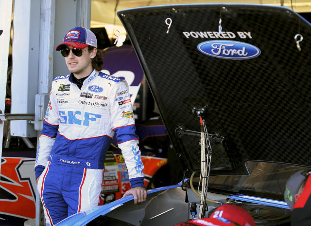 "<a class=""link rapid-noclick-resp"" href=""/nascar/nationwide/drivers/3085"" data-ylk=""slk:Ryan Blaney"">Ryan Blaney</a> stands next to his race car before practice for the NASCAR Cup Series auto race at Phoenix International Raceway, Friday, Nov. 10, 2017, in Avondale, Ariz. Blaney is one of five drivers looking to fill the final spot for the Championship 4. (AP Photo/Ralph Freso)"