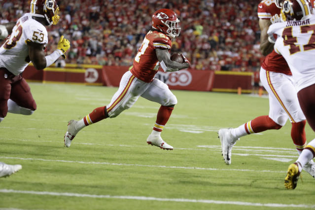 Kareem Hunt has had over 100 total yards in each of his first four NFL games. (AP Photo/Charlie Riedel)