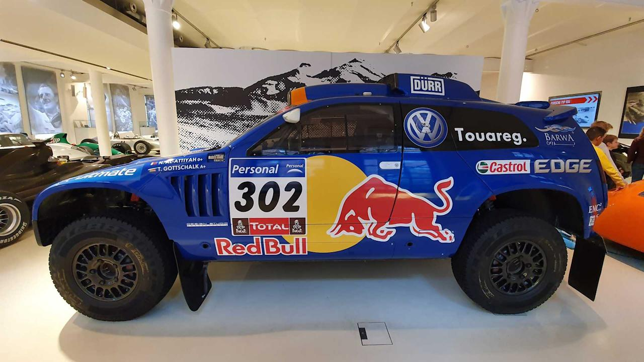 """<p>This Volkswagen Touareg may be pretty useless for the school run, but there's no denying its off-road credentials.</p> <p>After Dakar rally wins in four years with the Race Touareg 2, Volkswagen introduced the third-generation of the machine in 2011.</p> <p>The 310 bhp, twin-turbo diesel racer was instantly successful, winning the Dakar once again giving Nasser Al-Attiyah the first of his three Dakar victories and Volkswagen its most recent.</p><h2>More motoring museums</h2><ul><li><a href=""""https://uk.motor1.com/news/251681/mercedes-museum-stuttgart-merc-paradise/?utm_campaign=yahoo-feed"""">The Mercedes Museum in Stuttgart is a Merc lovers paradise</a></li><br><li><a href=""""https://uk.motor1.com/features/237276/car-museum-plans-cotswolds/?utm_campaign=yahoo-feed"""">A world-leading car museum is being planned for the Cotswolds</a></li><br></ul>"""
