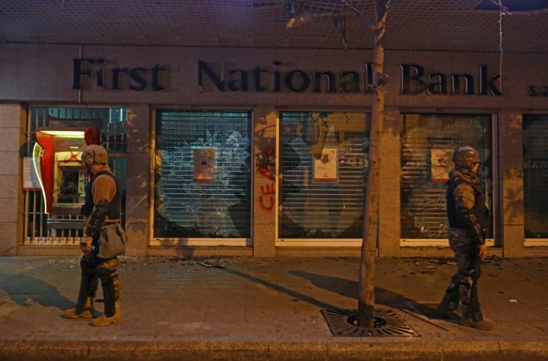 Soldiers stand guard outside a bank attacked by protesters during ongoing demonstrations in Lebanon's capital Beirut (AFP Photo/ANWAR AMRO)